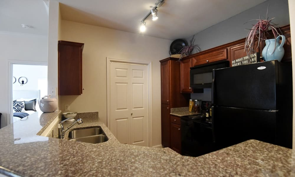 Augusta Meadows offers a kitchen with granite countertops in Tomball, Texas