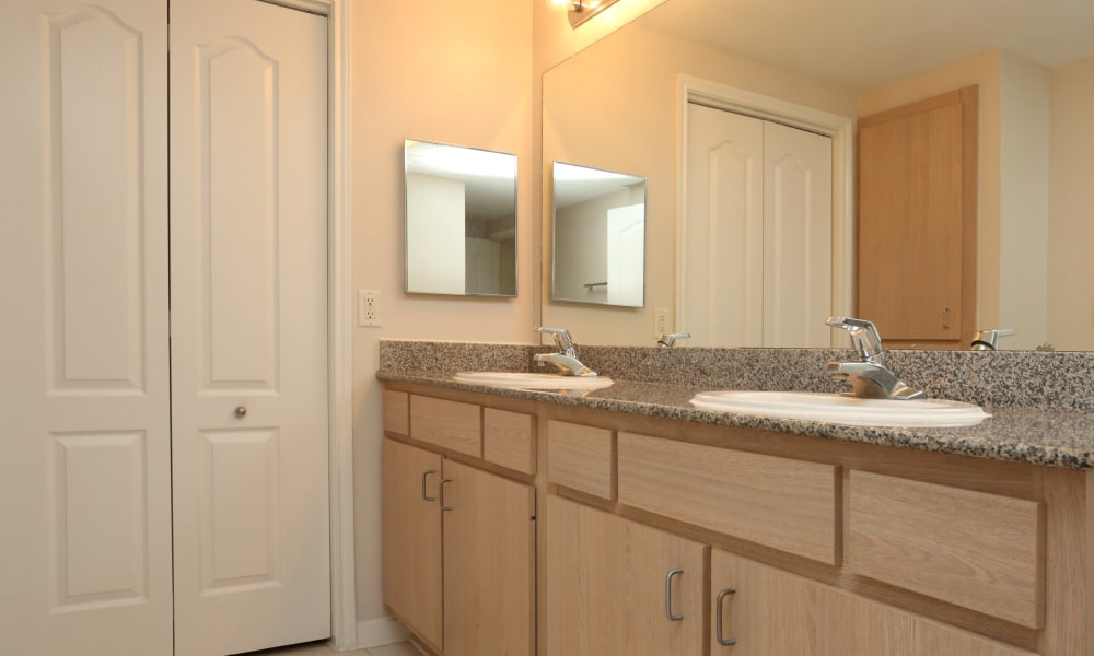 Bathroom with granite countertop at Cornerstone Ranch Apartments in Katy, Texas