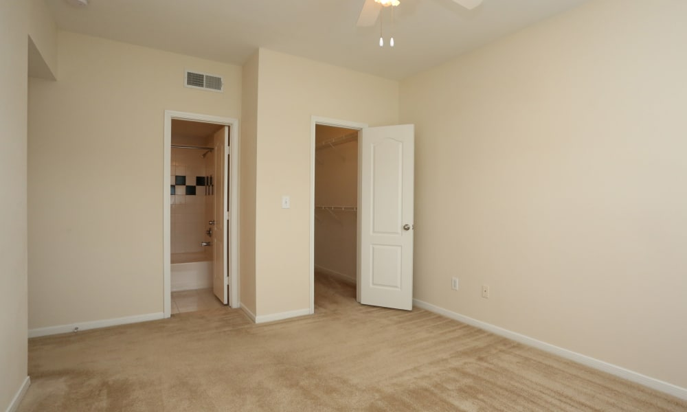 Bedroom with walk-in closet at Cornerstone Ranch Apartments in Katy, Texas