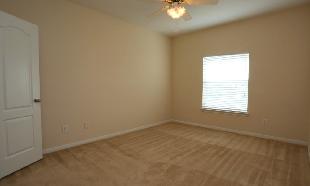 Spacious empty bedroom at Cornerstone Ranch Apartments in Katy, Texas
