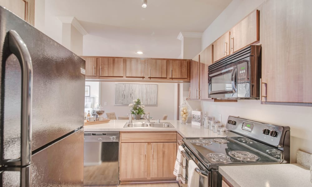Fully equipped kitchen at Thornbury Apartments in Houston, Texas