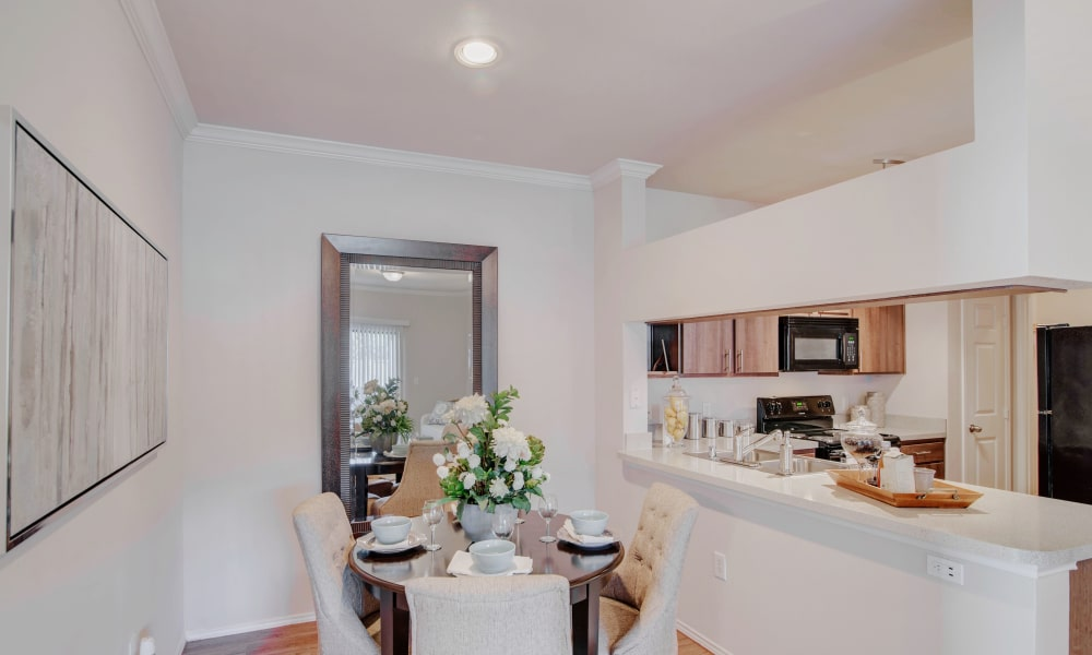 Dining and kitchen room combo at Thornbury Apartments in Houston, Texas