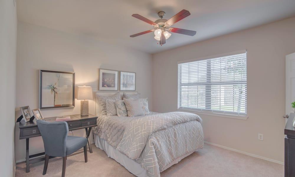 Cozy bedroom at Thornbury Apartments in Houston, Texas