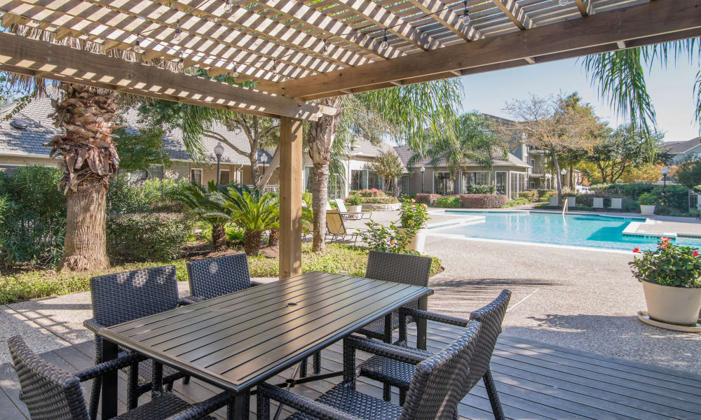 Dining table and our pool at Thornbury Apartments in Houston, Texas