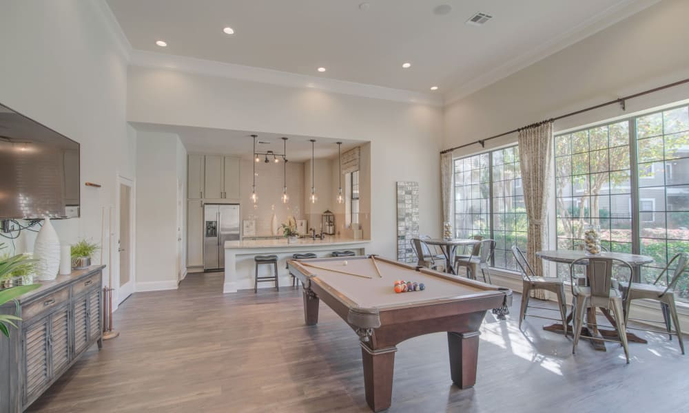 Clubhouse with billiards table at Thornbury Apartments in Houston, Texas