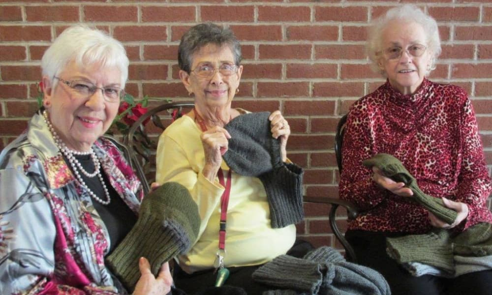 Residents at knitting workshop at Arbour Square of Harleysville