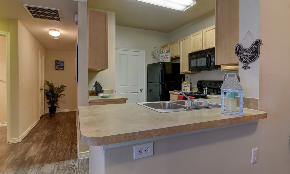 Kitchen with breakfast bar at Hillstone Ranch Apartments in San Antonio, Texas