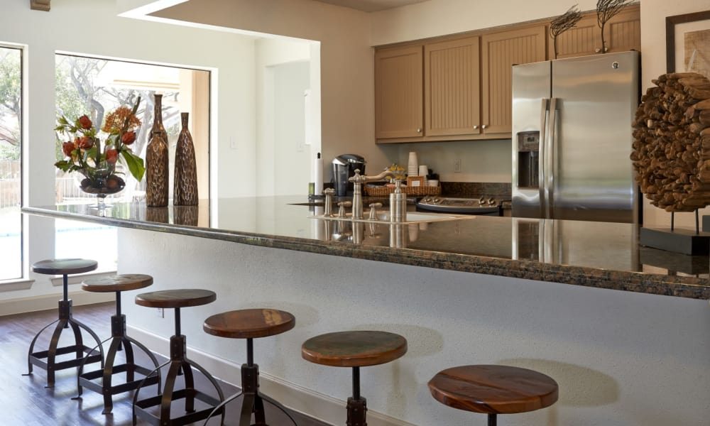Clubhouse kitchen with breakfast bar at Retreat at Hart Ranch in San Antonio, Texas