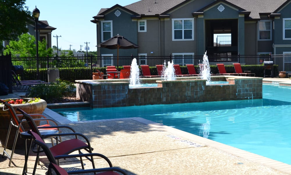 Swimming pool with furniture at Club at Stone Oak in San Antonio, Texas