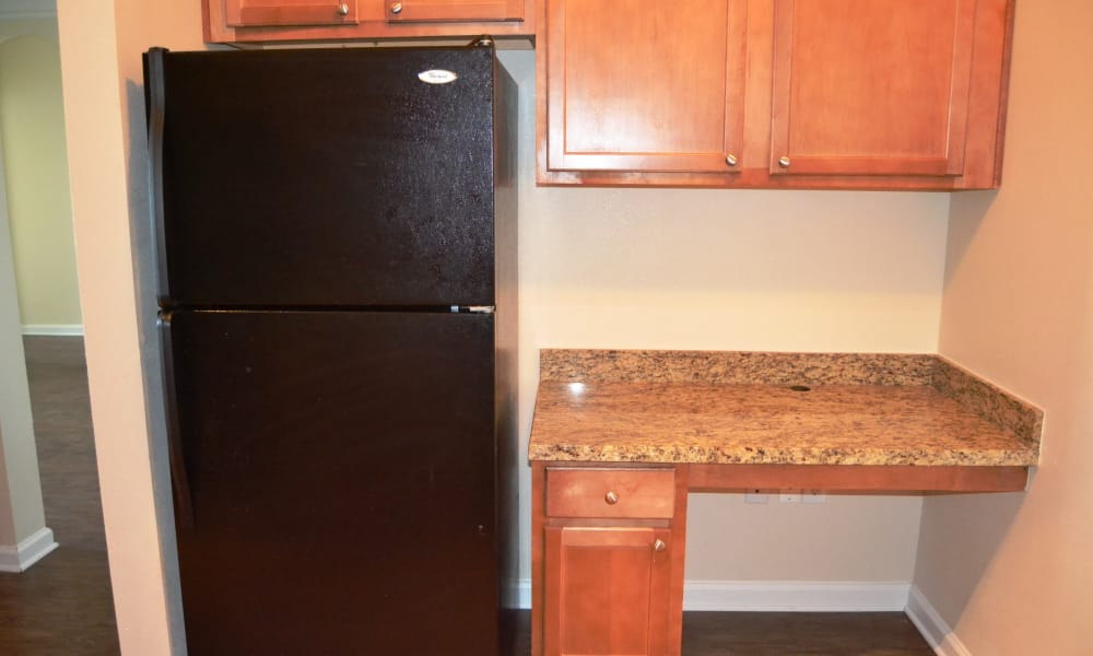 Club at Stone Oak offers a kitchen with granite counter top in San Antonio, Texas