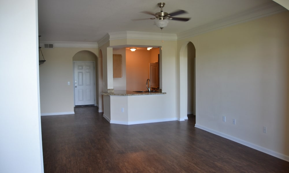 Apartment interior with hardwood flooring at Club at Stone Oak in San Antonio, Texas