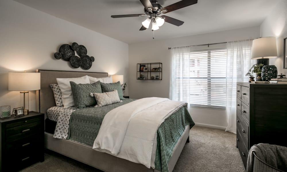Naturally well-lit bedroom at Landmark Apartments Tuscaloosa in Tuscaloosa, Alabama