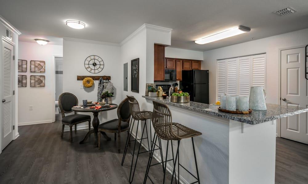 Kitchen with breakfast bar at Landmark Apartments Tuscaloosa in Tuscaloosa, Alabama