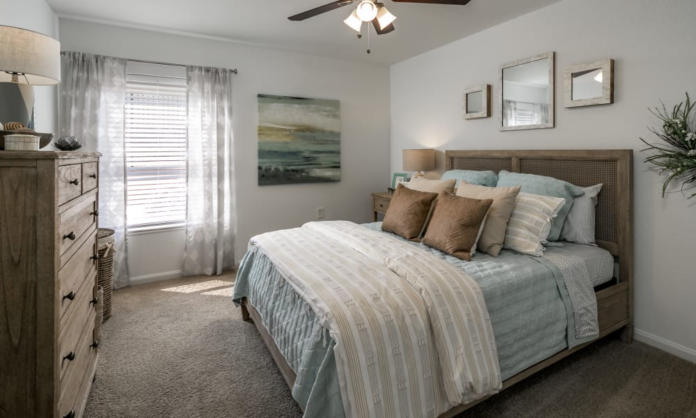 Naturally well-lit bedroom at Landmark Apartments Hattiesburg in Hattiesburg, Mississippi