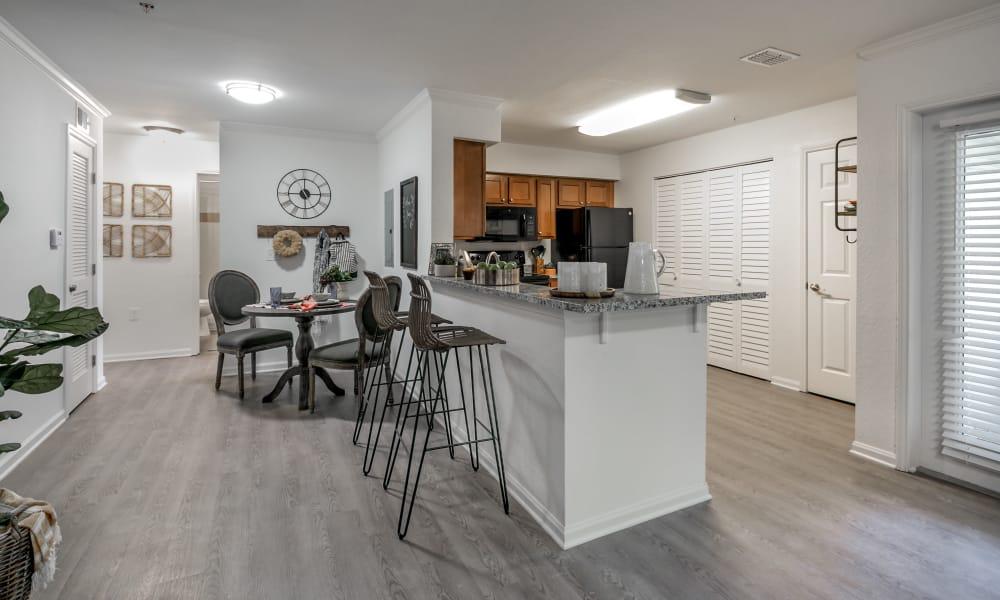 Kitchen with breakfast bar at Landmark Apartments Hattiesburg in Hattiesburg, Mississippi