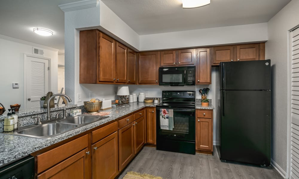 Spacious kitchen with granite countertops at Landmark Apartments Hattiesburg in Hattiesburg, Mississippi