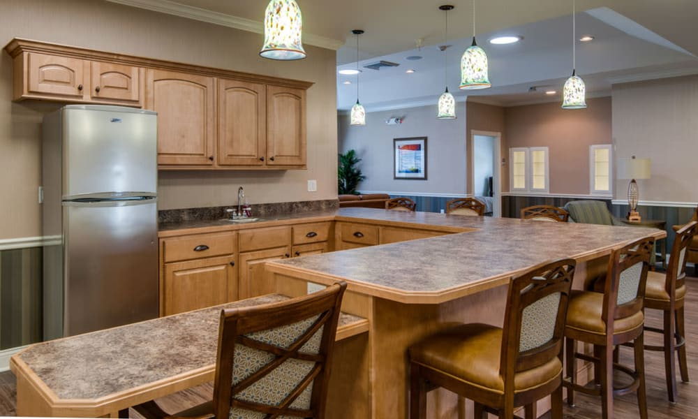 Community kitchen with accessible counters at Ravenwood Terrace Senior Living in Moberly, Missouri