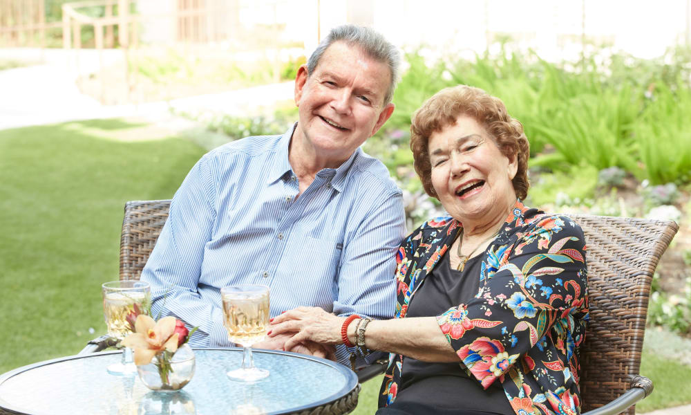 Senior couple at Regency Park Oak Knoll in Pasadena, California enjoying a laugh