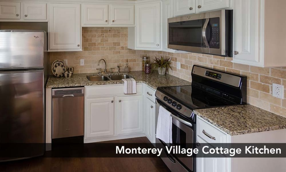 Modern kitchen with stainless-steel appliances at Monterey Village Senior Living in Lawrence, Kansas