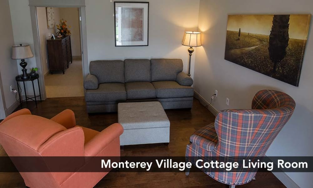 Well decorated Living Room with hardwood-style floors at Monterey Village Senior Living in Lawrence, Kansas