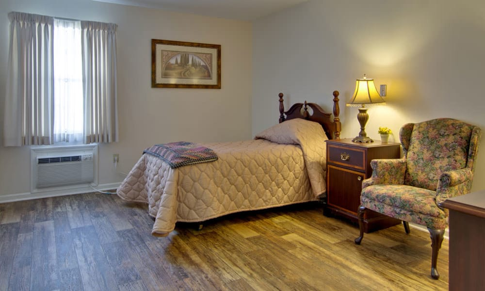 Individual living spaces with wood-style flooring at The Arbors at Lakeview Bend in Mexico, Missouri