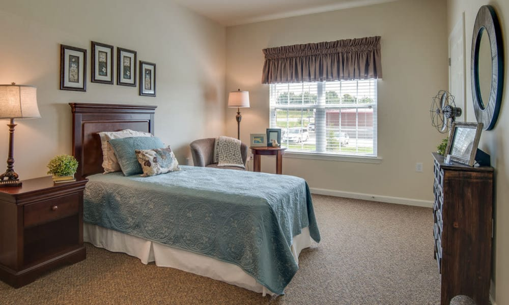 Model senior living bedroom at Ravenwood Terrace Senior Living community in Moberly, Missouri
