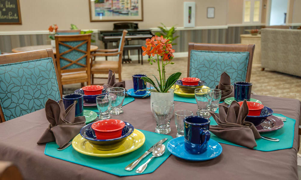 Colorful table setting in dining room at Ravenwood Terrace Senior Living in Moberly