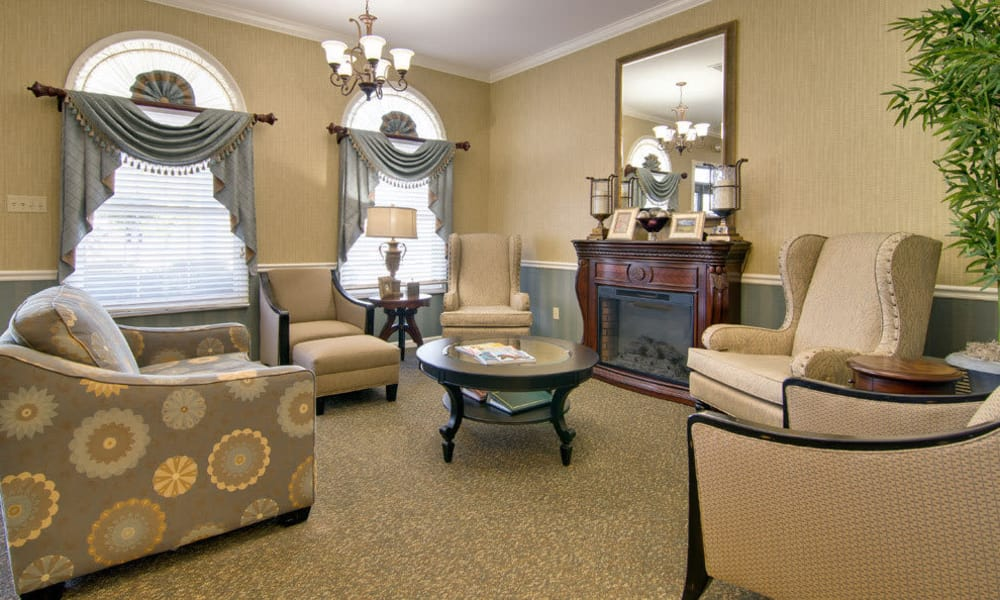Cozy living room area at Ravenwood Terrace Senior Living in Moberly
