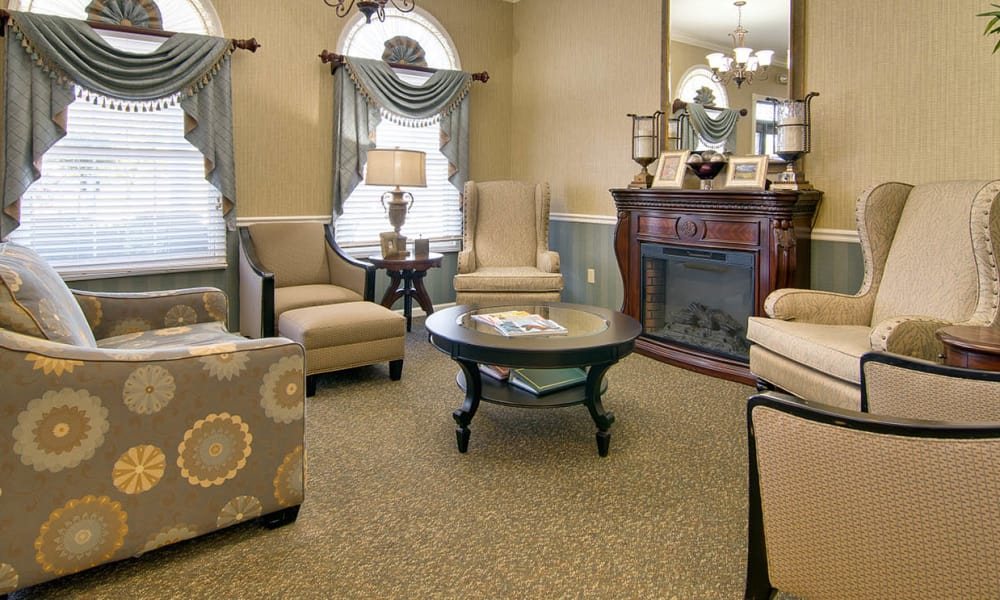 Cozy living room for assisted living residents at Ravenwood Terrace Senior Living in Moberly, Missouri