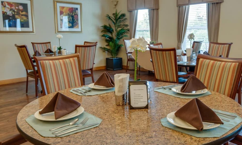 Dining table set for a meal at Victorian Place of Owensville in Owensville, Missouri