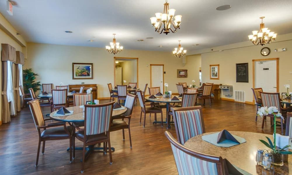 Large dining hall with hardwood floors at Victorian Place of Owensville in Owensville, Missouri