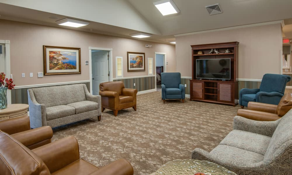Carpeted seating in the TV lounge at Adams Pointe Senior Living in Quincy, Illinois