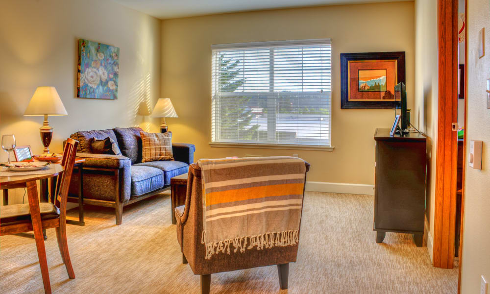 Couch and chair inside room at The Creekside in Woodinville, Washington