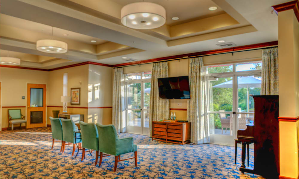Common area with television at chairs at The Creekside in Woodinville, Washington