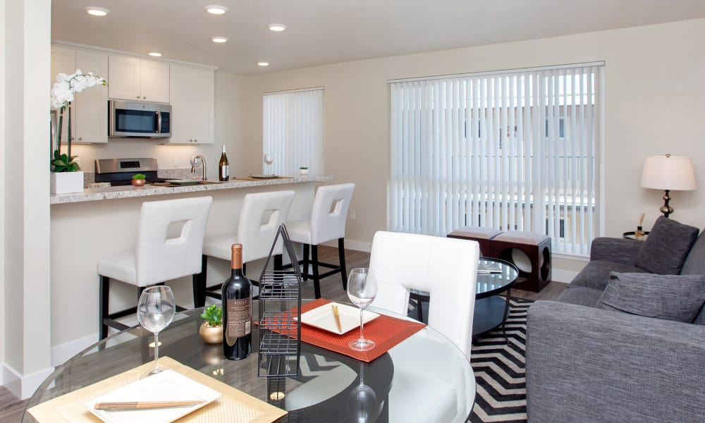 Living area and kitchen views from dining area in model home at The Arlington in Burlingame, CA
