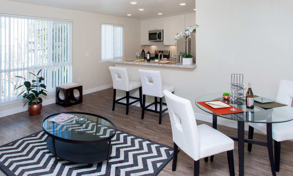 View of dining area and kitchen from model home's living area at The Arlington in Burlingame, CA