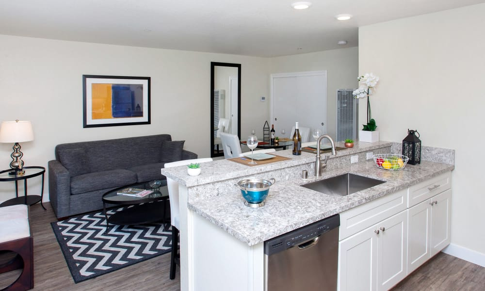 Open-concept floor plan view of the living area from the kitchen at The Arlington in Burlingame, CA