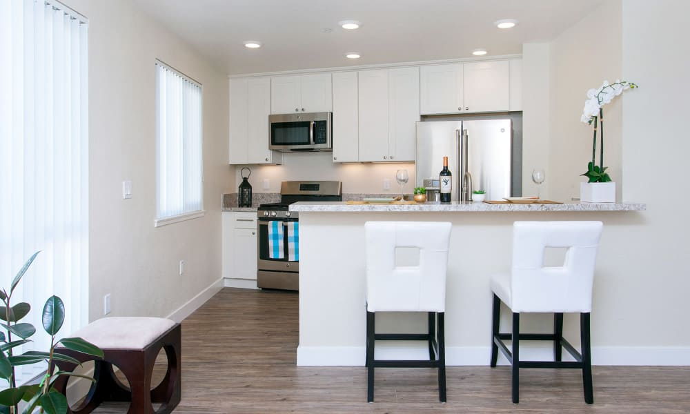 Model home at The Arlington in Burlingame, CA, offers hardwood flooring and white cabinetry.