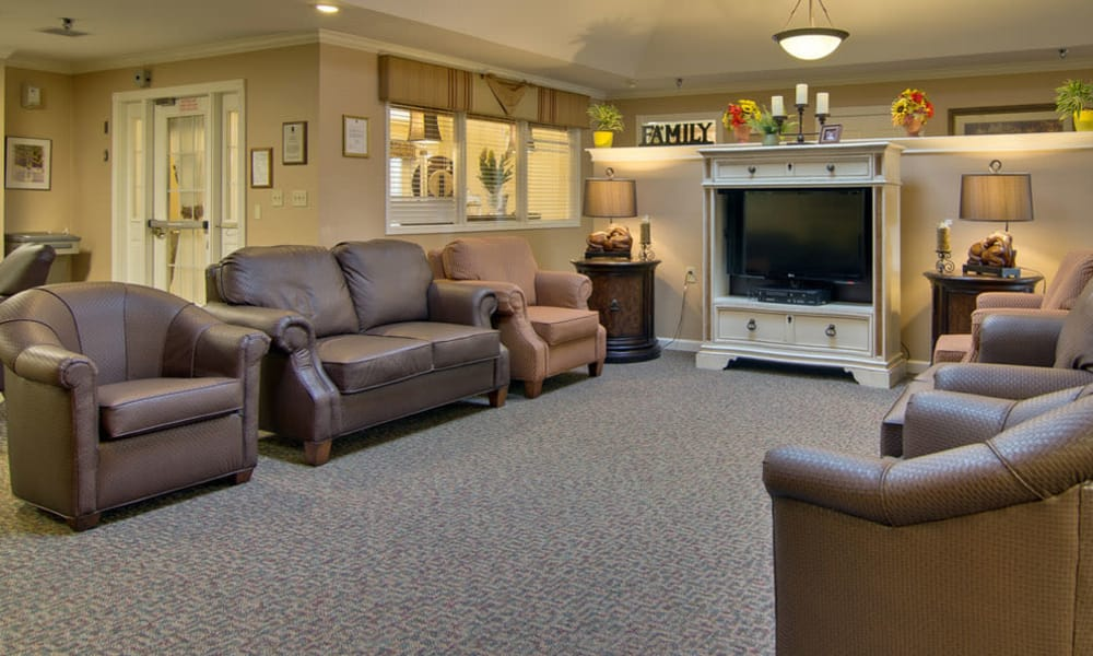 Entertainment room with comfortable seating at Bluff Creek Terrace Senior Living in Columbia, Missouri