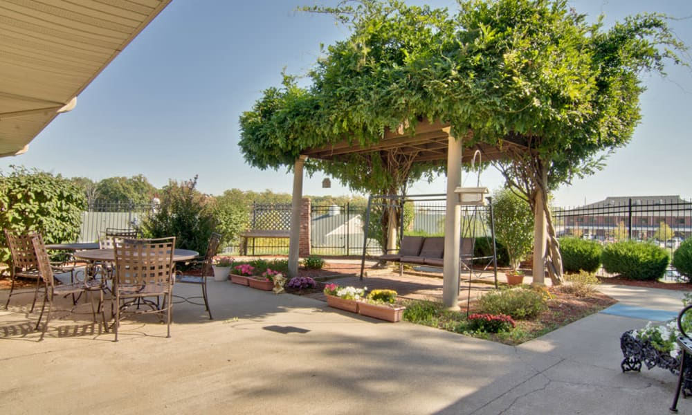 Outdoor patio swing at Bluff Creek Terrace Senior Living in Columbia, Missouri