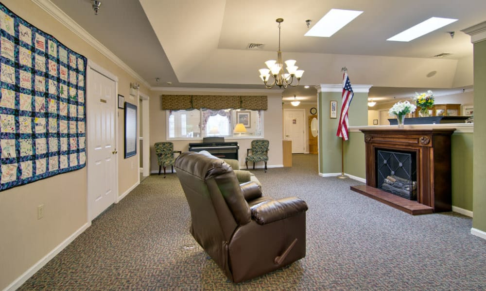 Sitting area with a fireplace at South Pointe Senior Living in Washington, Missouri