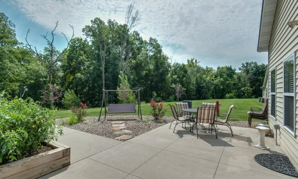 Concrete patio with seating at Victorian Place of Washington Senior Living in Washington, Missouri