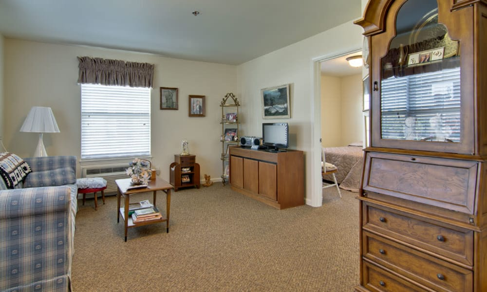 Apartment living room at Sugar Creek Senior Living in Troy, Missouri