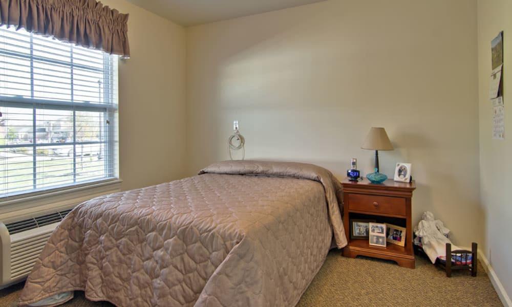 One bedroom at Sugar Creek Senior Living in Troy, Missouri