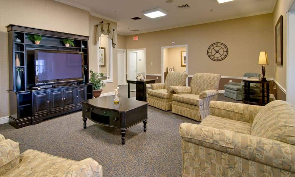 Entertainment room with comfortable seating at Sugar Creek Senior Living in Troy, Missouri