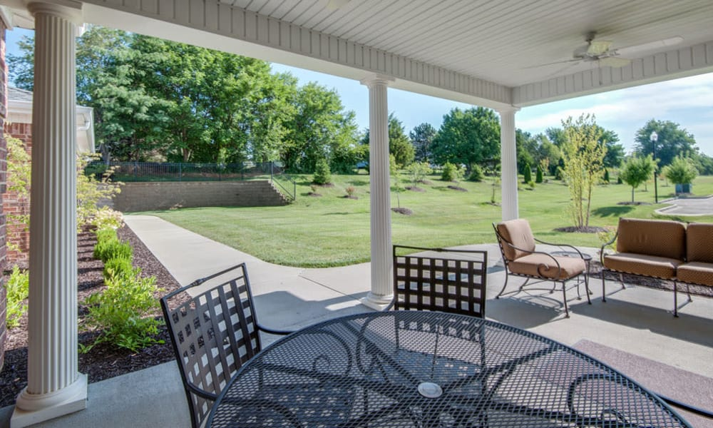 Covered patio with seating at Maplebrook Senior Living in Farmington, Missouri