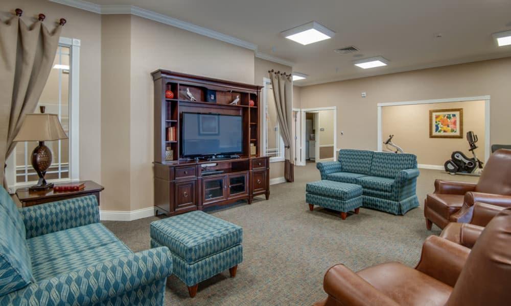 Entertainment room with comfortable seating at Maplebrook Senior Living in Farmington, Missouri