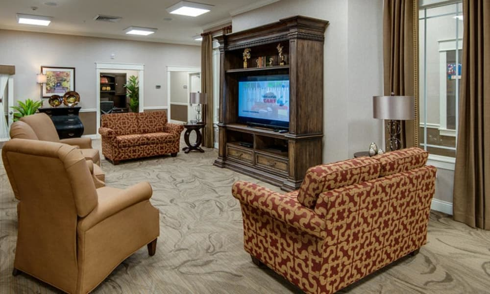 Entertainment room with comfortable seating at Mattis Pointe Senior Living in Saint Louis, Missouri