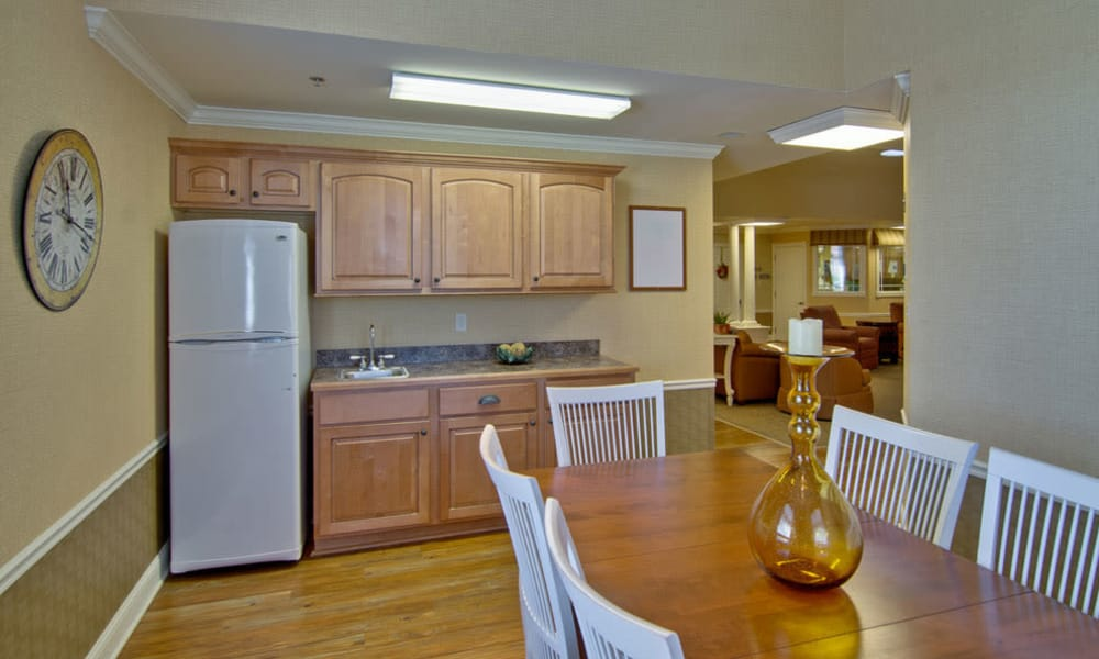 Community kitchen with accessible counters at Chestnut Glen Senior Living in Saint Peters, Missouri