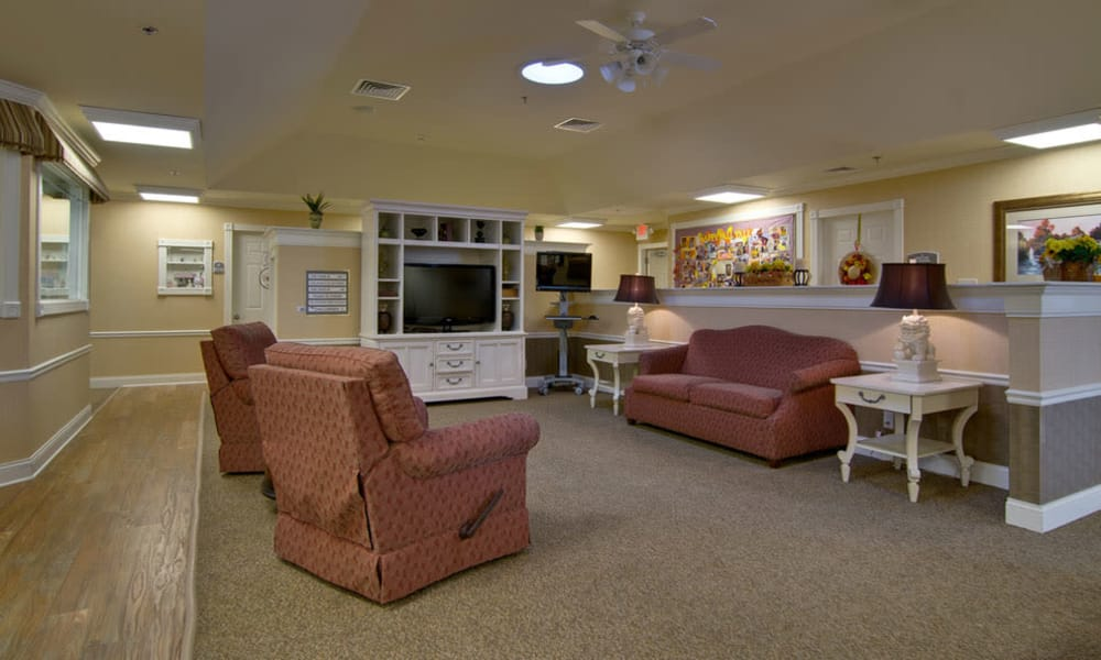 Entertainment room with comfortable seating at Chestnut Glen Senior Living in Saint Peters, Missouri
